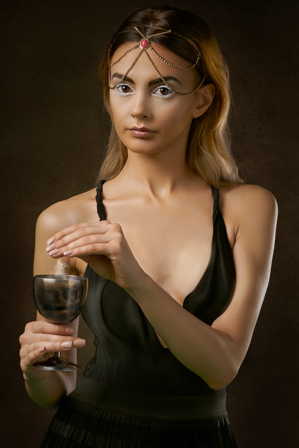 woman standing and holding glass of wine
