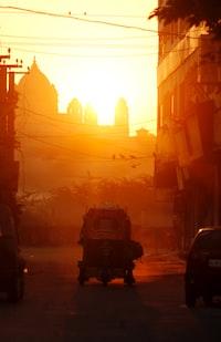 auto-rickshaw on road during golden hou