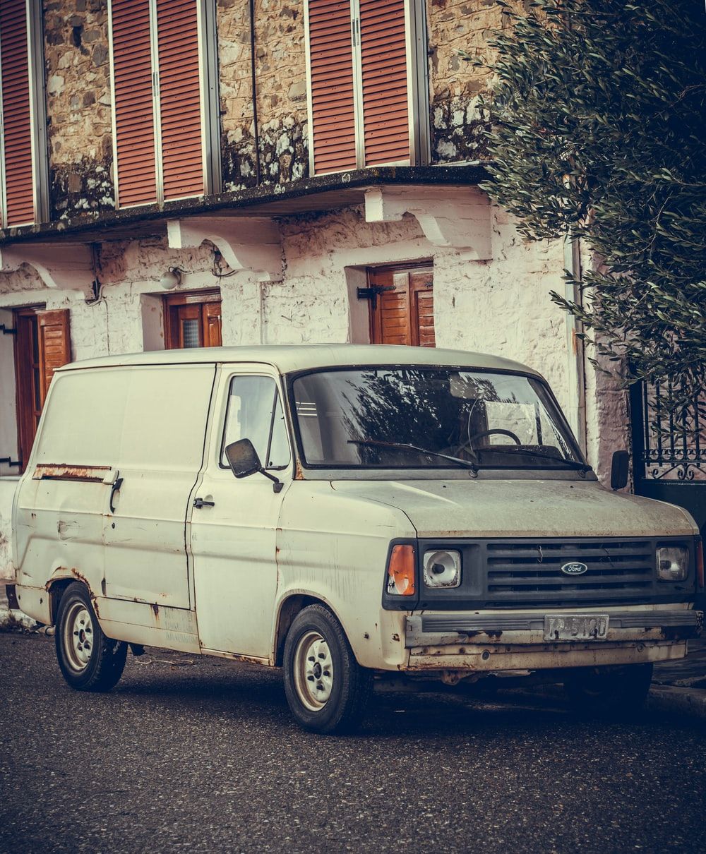 white Ford van parked outdoor
