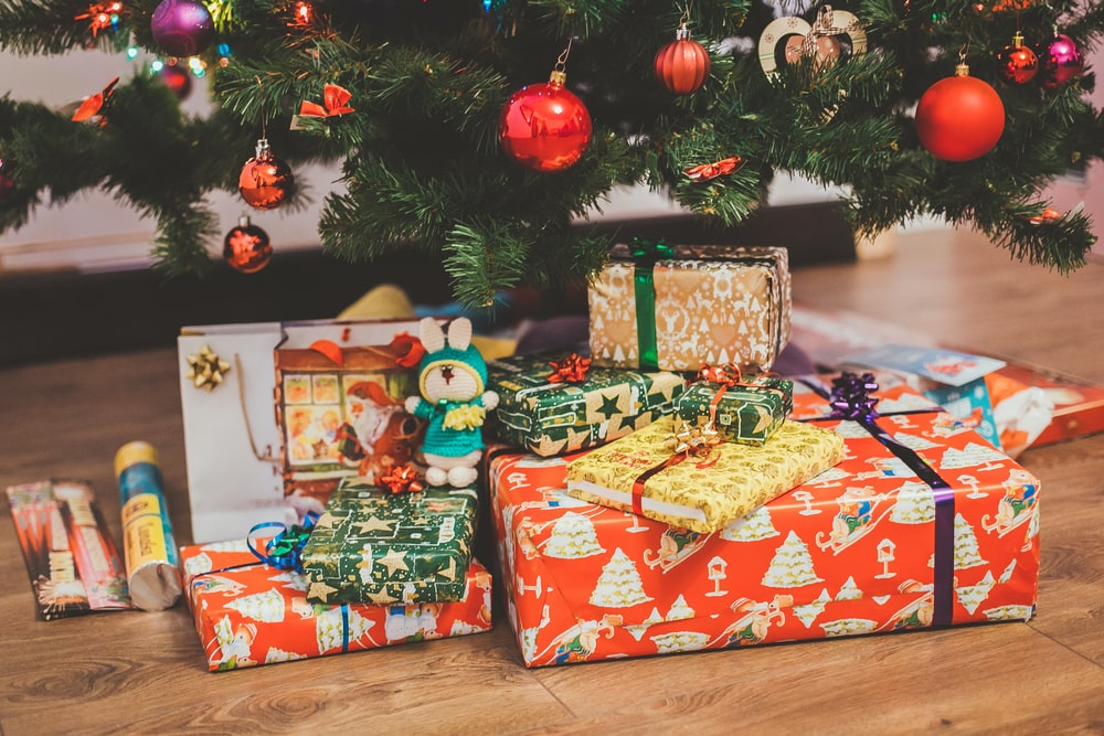 assorted-color gift box under Christmas tree