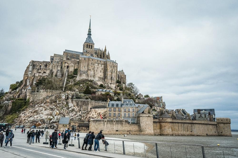 people walking near castle
