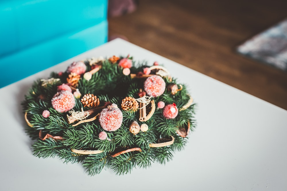 green and brown wreath on white surface