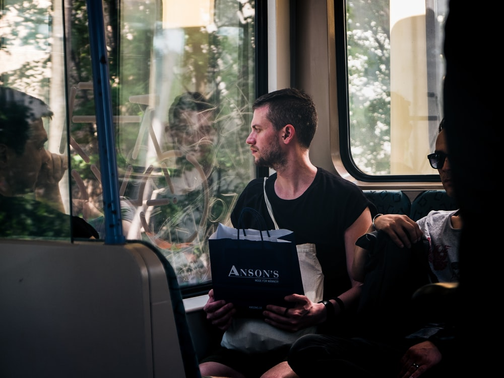 man sitting inside the bus