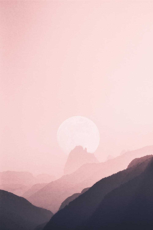moon near mountain ridge