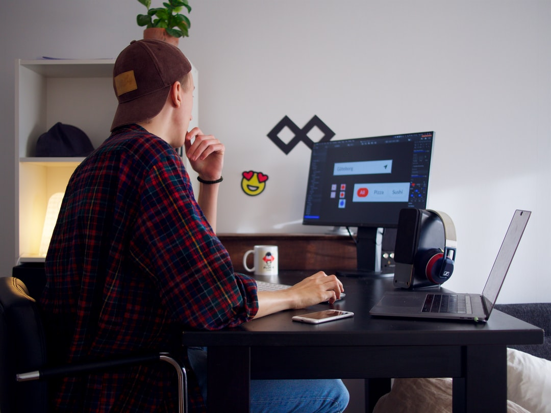 This is me, in my small minimalistic freelancing office. Monitor: Eizo FlexScan EV2450  Speakers: Creative GigaWorks T20