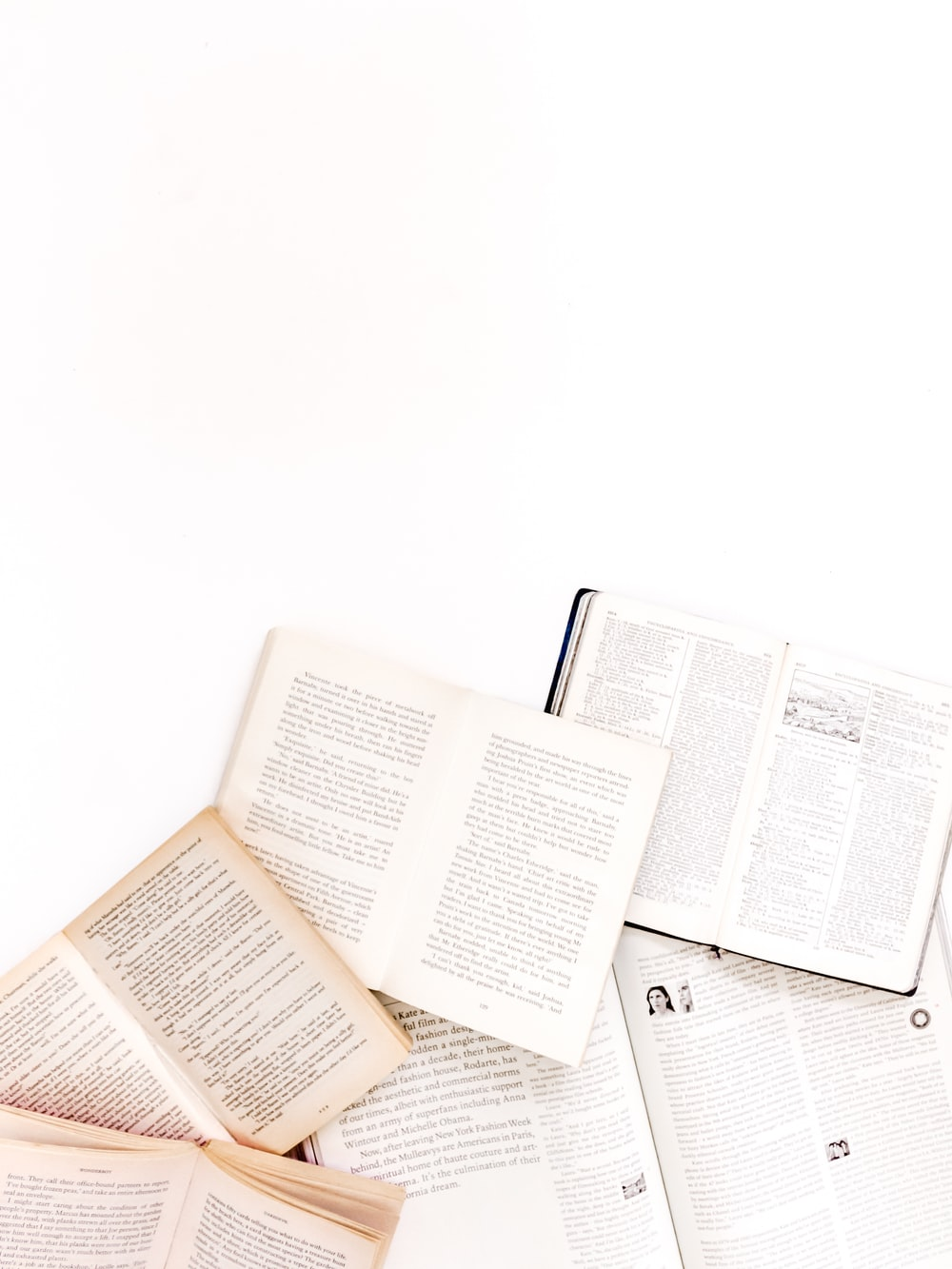 open books on white surface