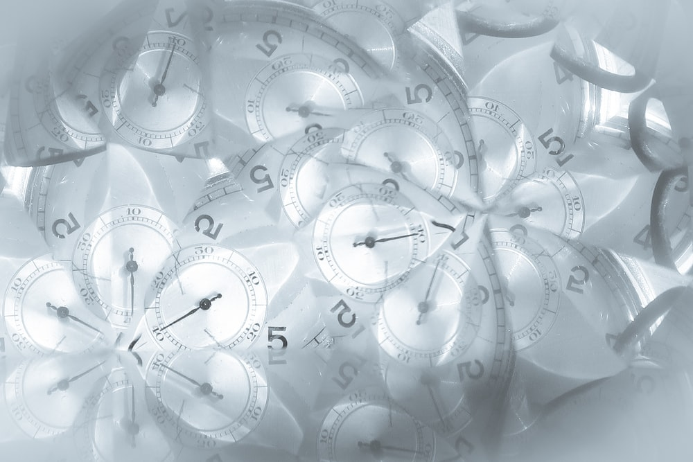 white and gray analog clock