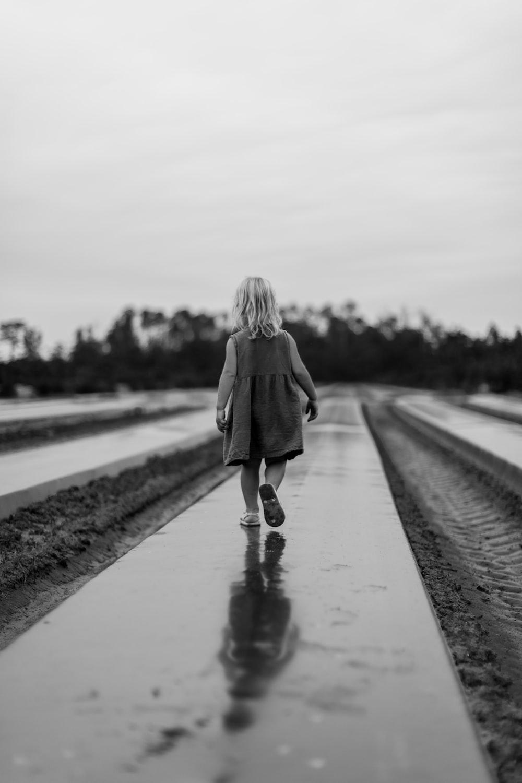 girl walking on pathway