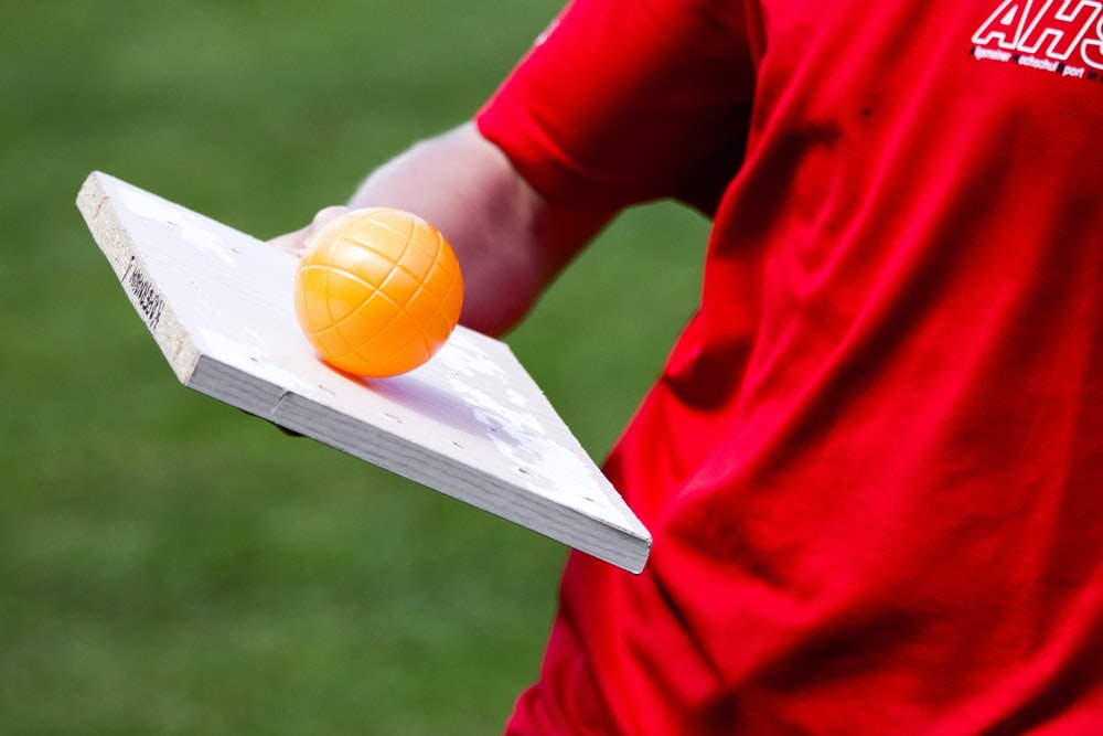 man balancing the orange ball