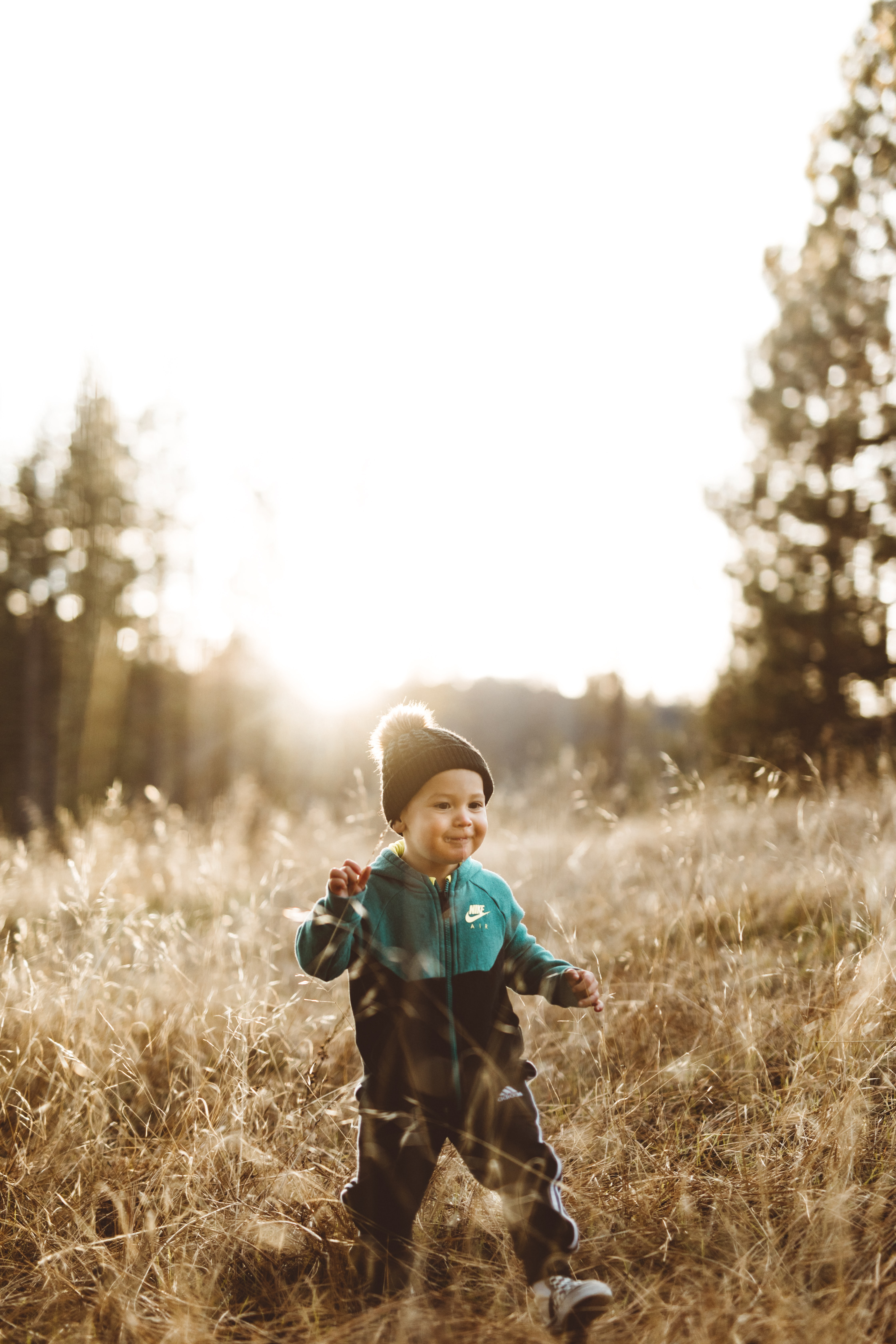 boy surrounded by grass