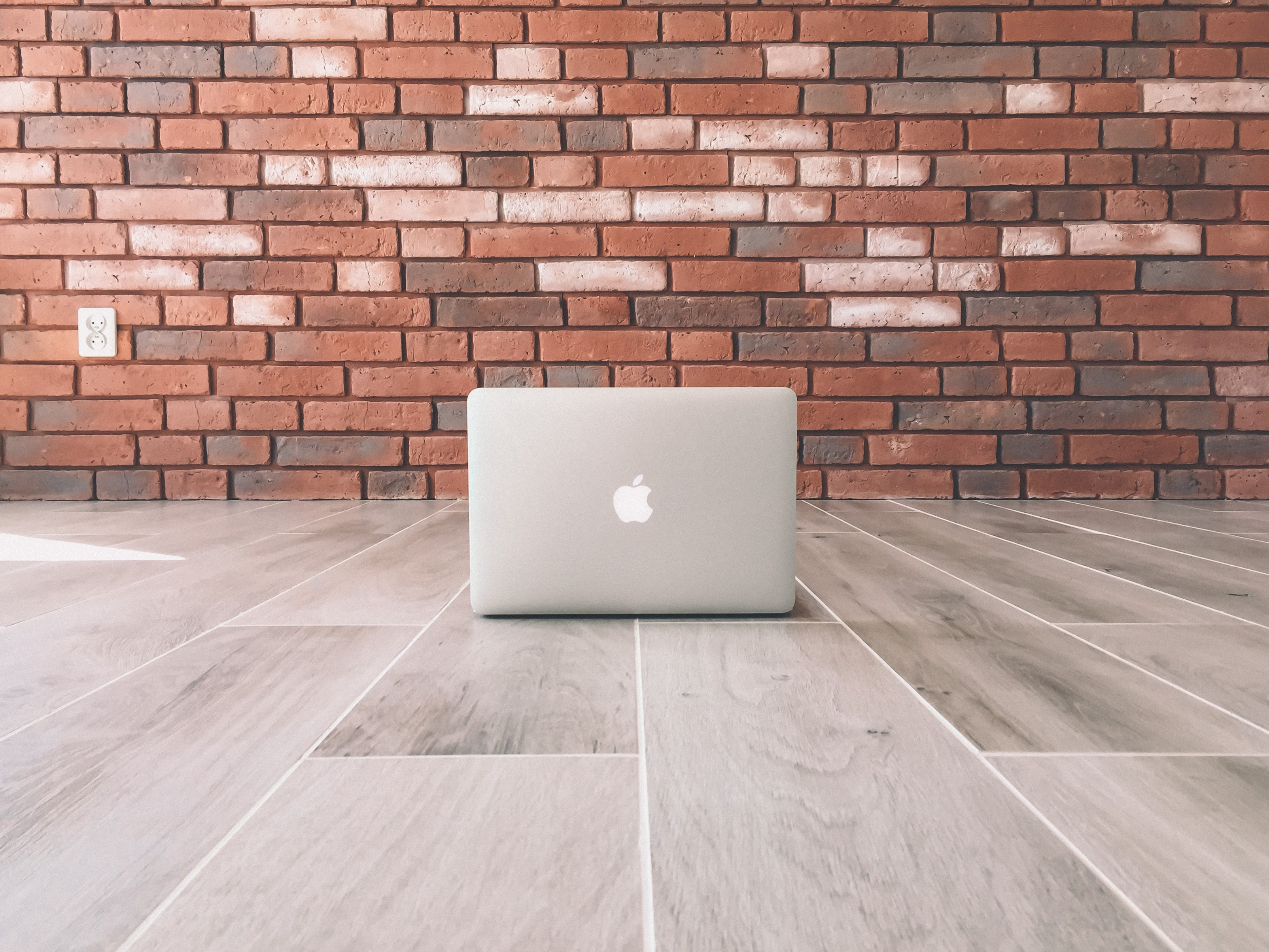 MacBook on floor