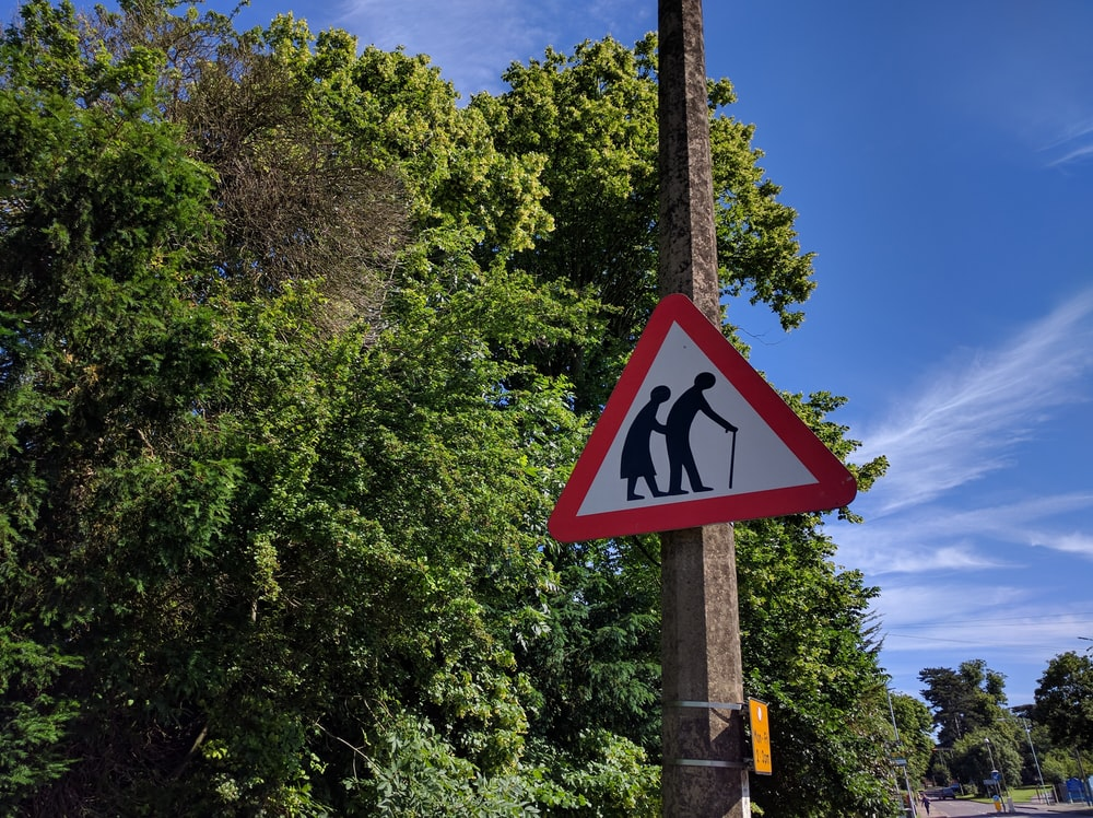 shallow focus photo of road sigange