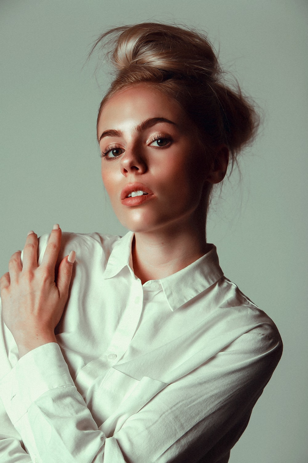 woman in white dress shirt