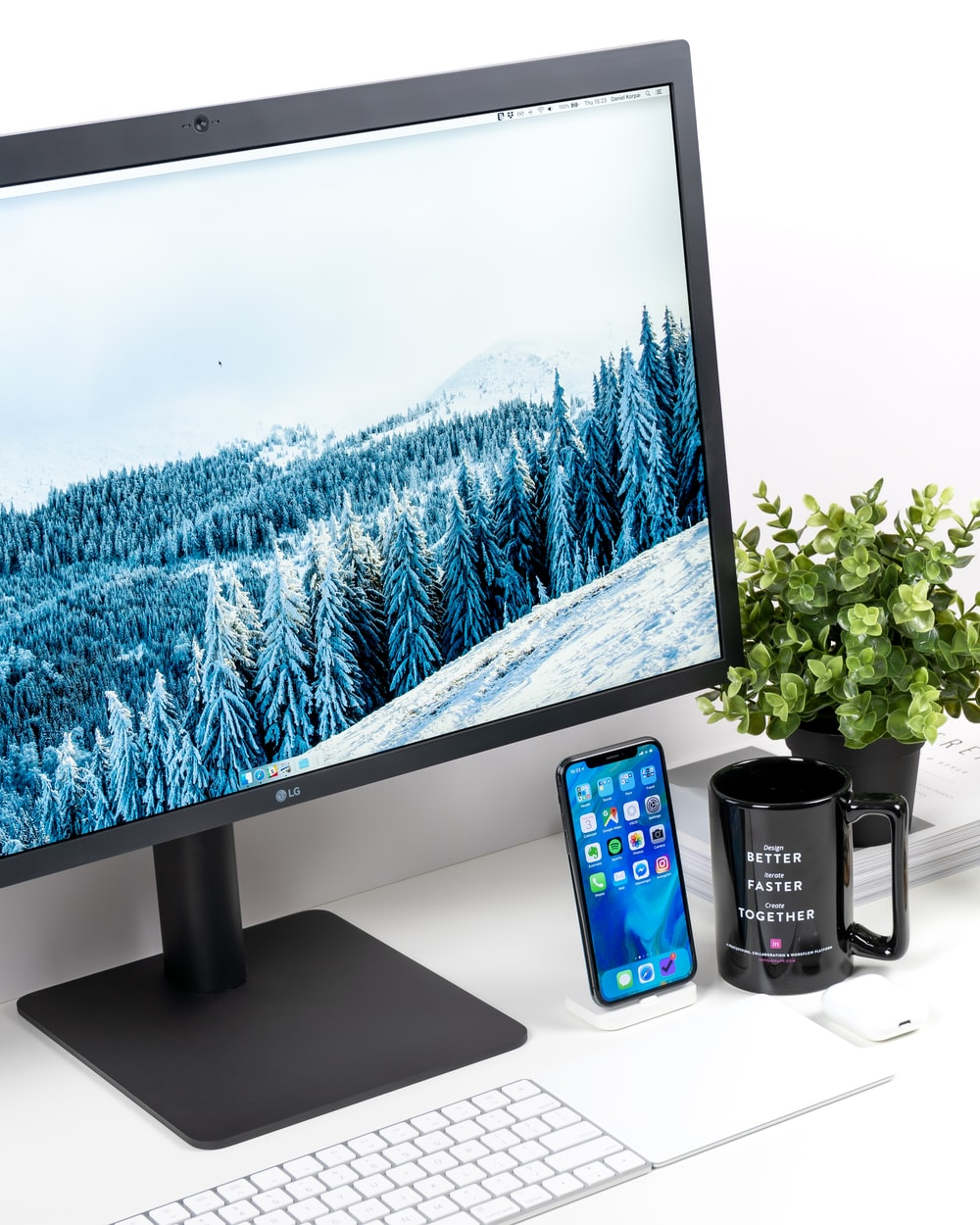 black LG monitor and white keyboard