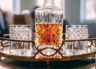 clear glass decanter filled with whisky