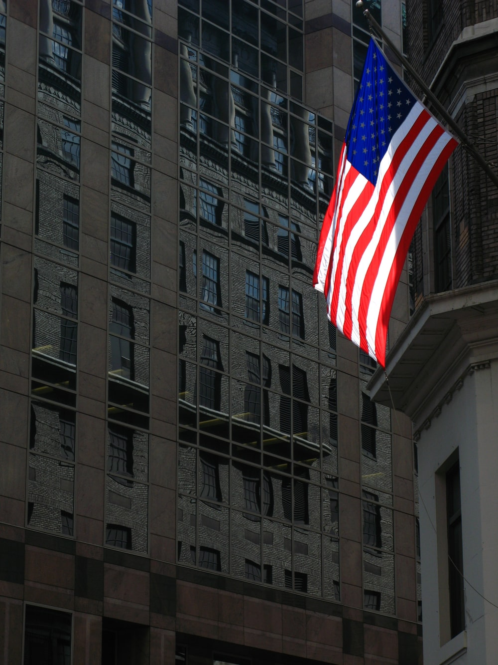 building with United States flag during daytime