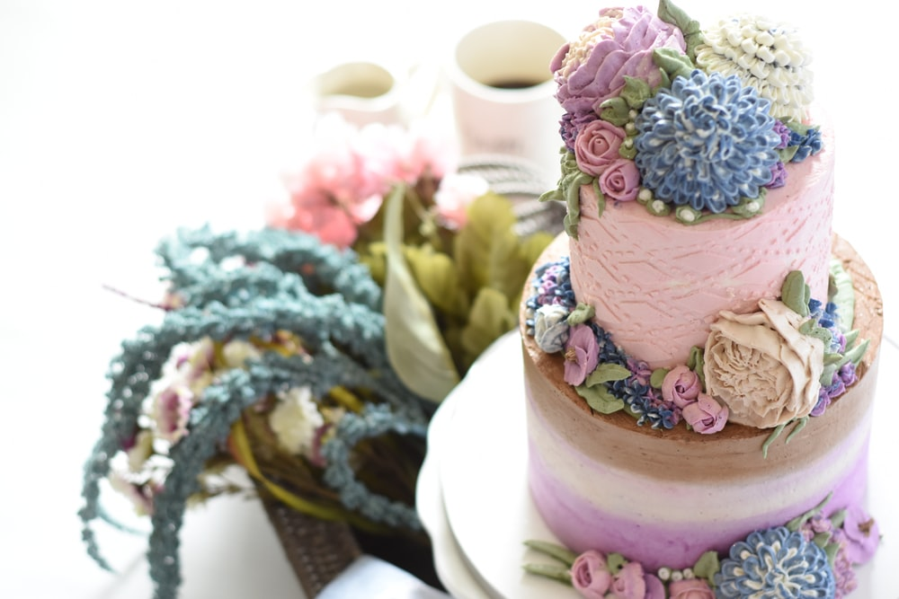 selective focus photography of pink icing covered cake
