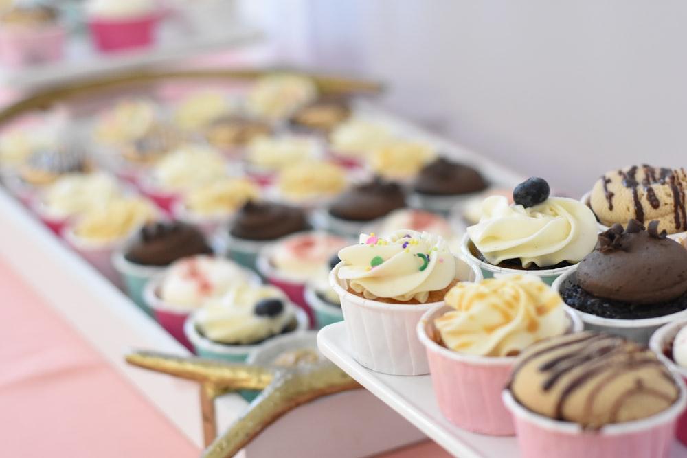 assorted-flavor cupcakes on selective focus photography