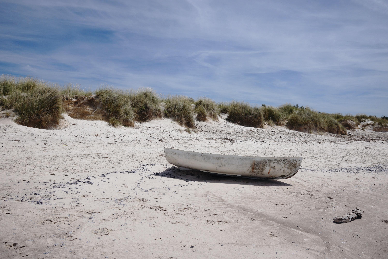 white boat on white sand