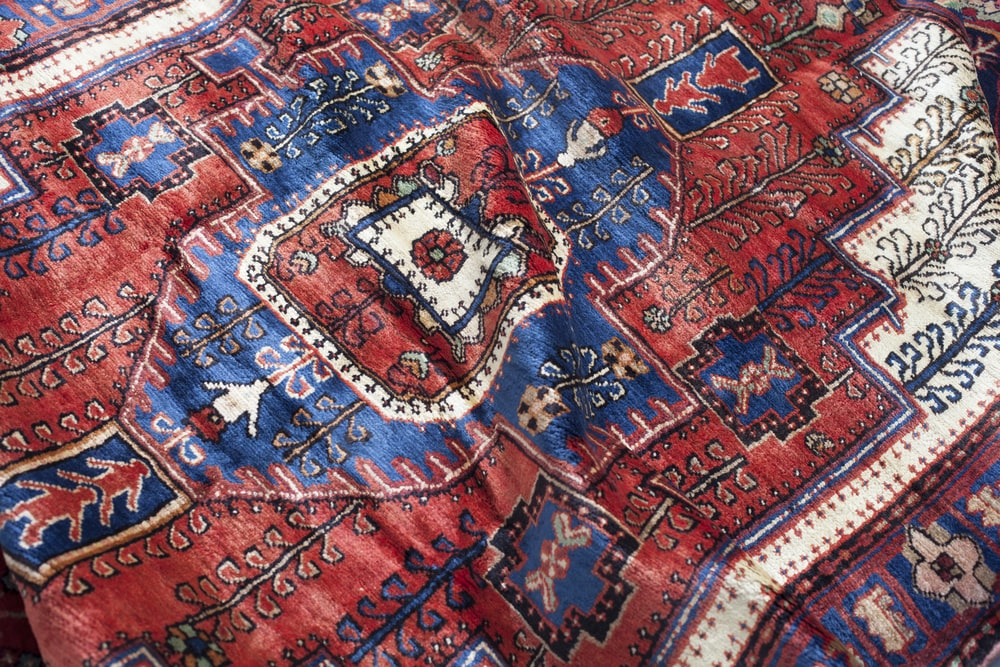 maroon and blue textile