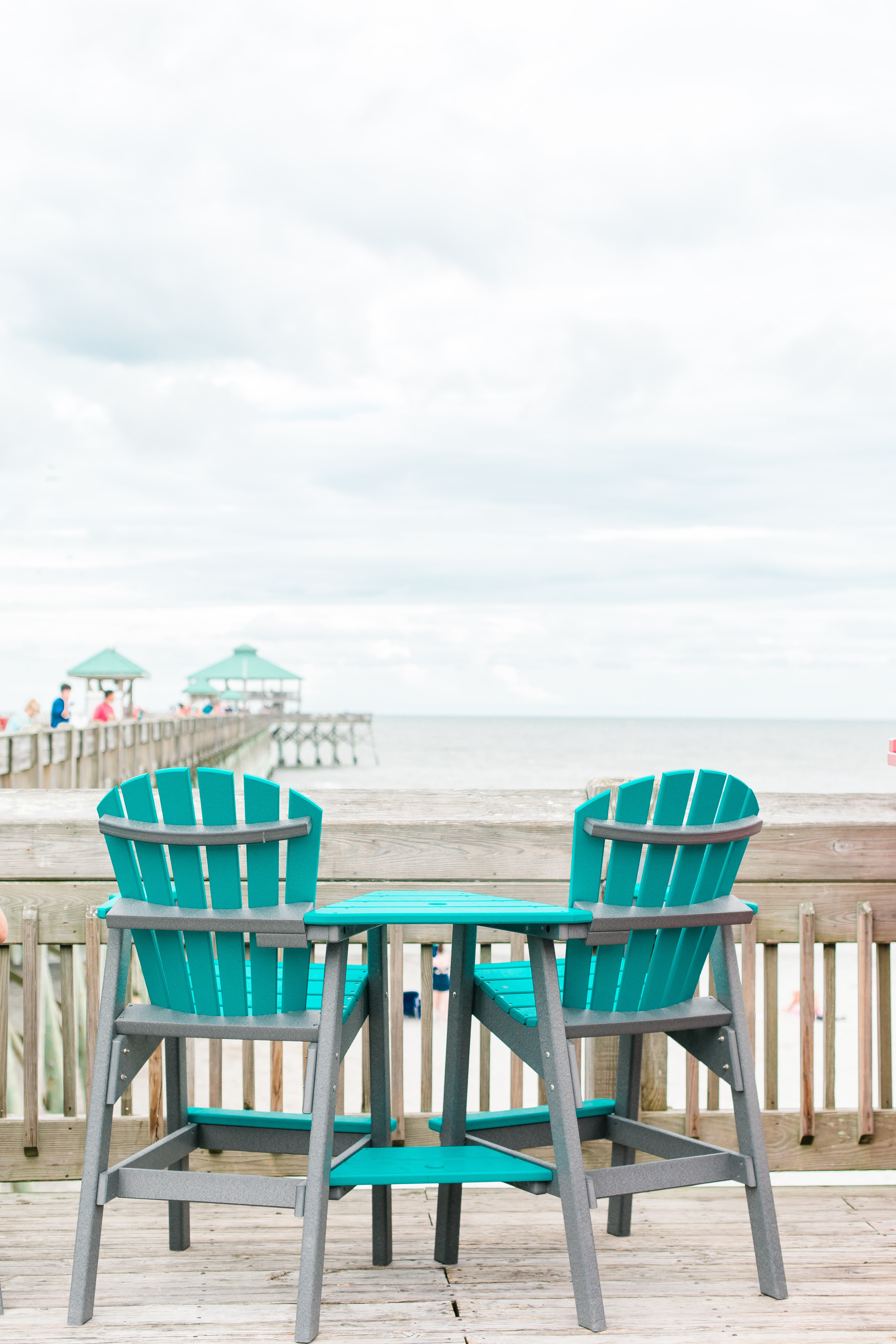 teal and white wooden table and chairs set