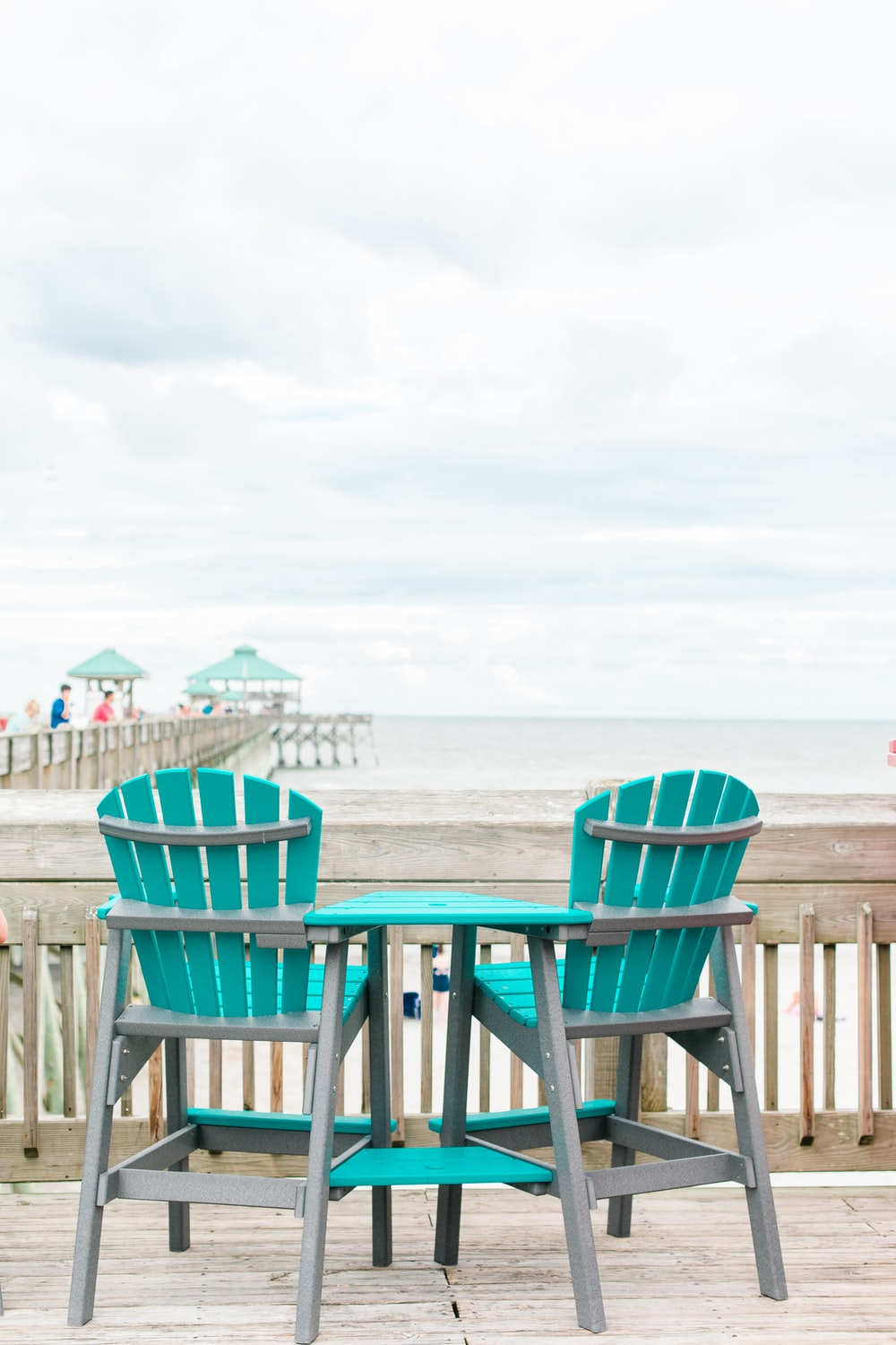 blue and gray wooden chair near shore