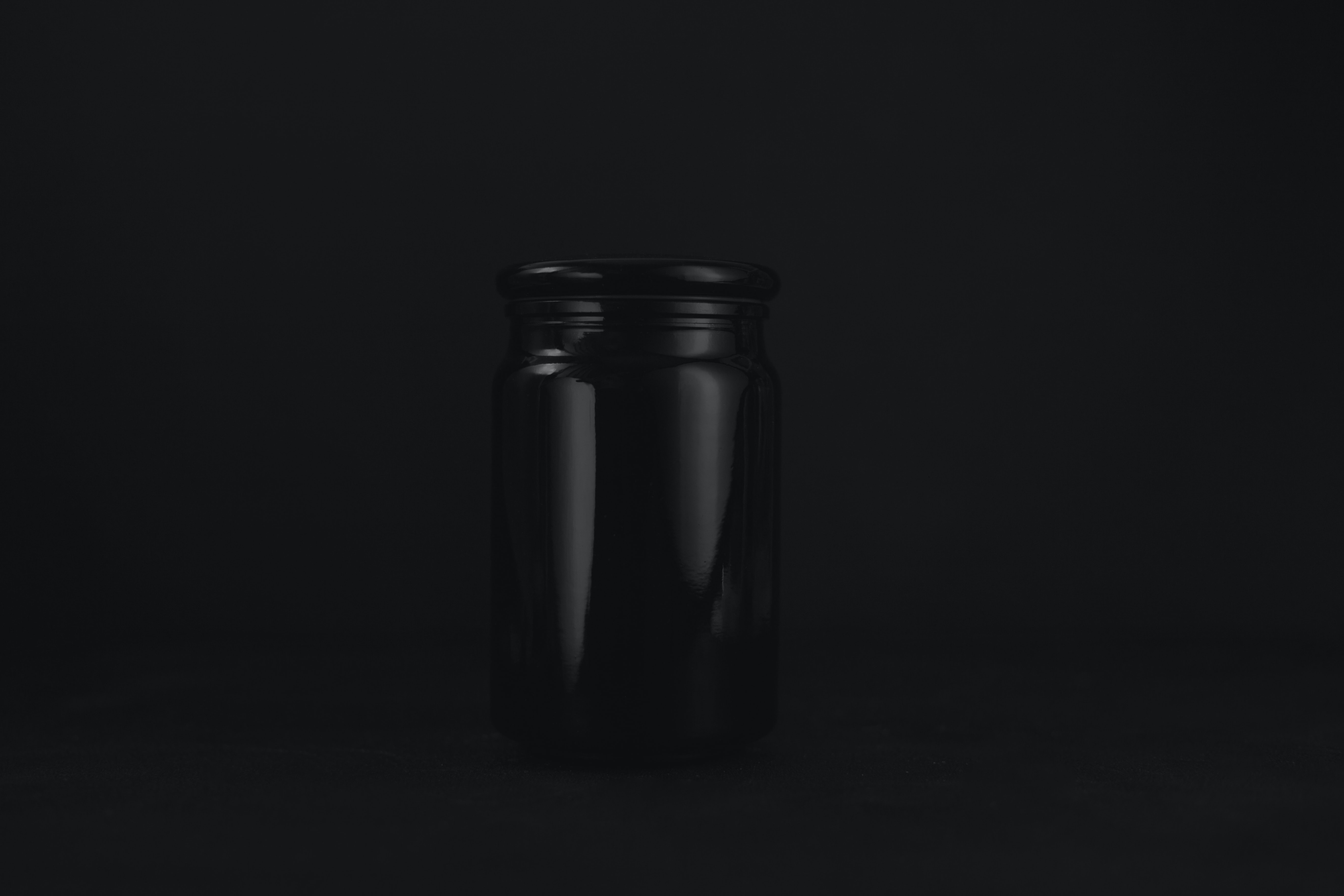 empty black glass jar