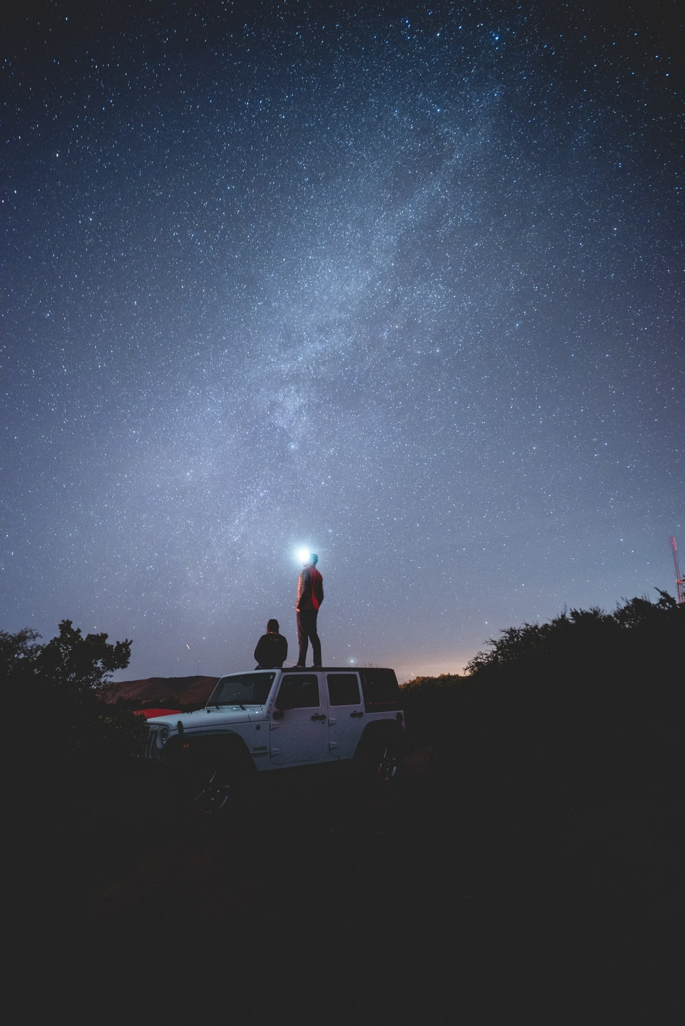 two person on white vehicle at night time