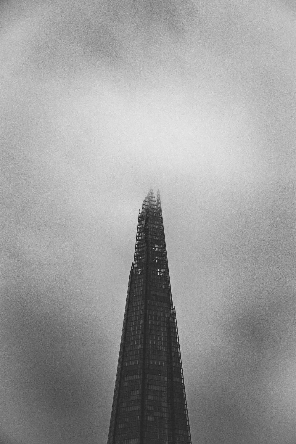 grayscale photography of high rise tower