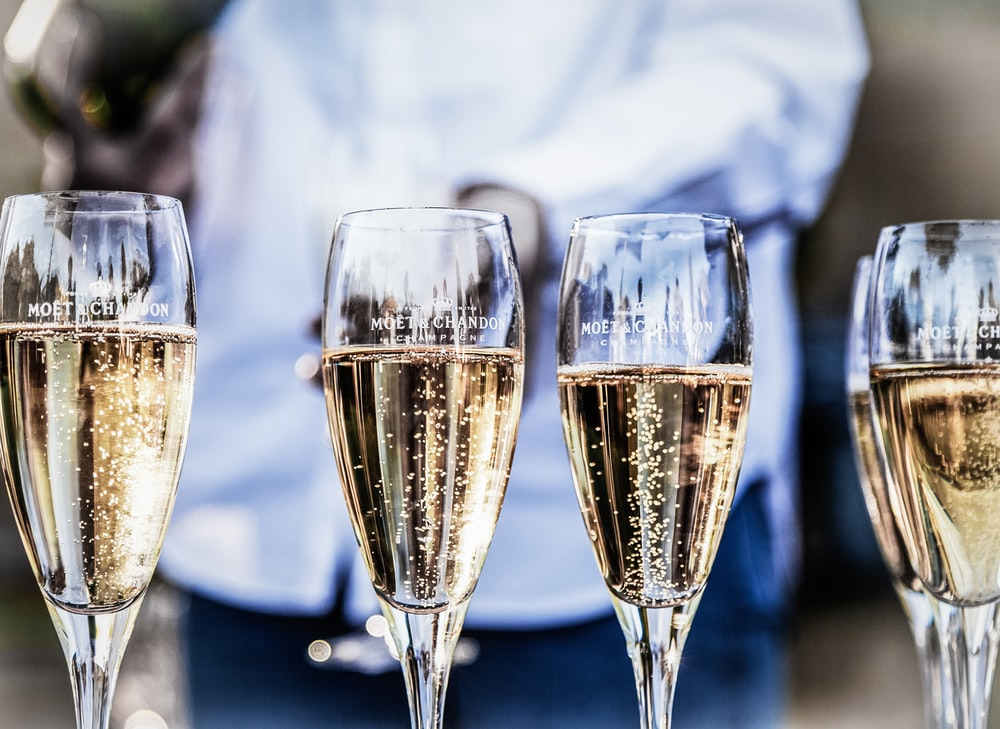 four clear champagne flutes