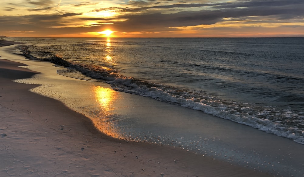 calm sea and shore under golden hour