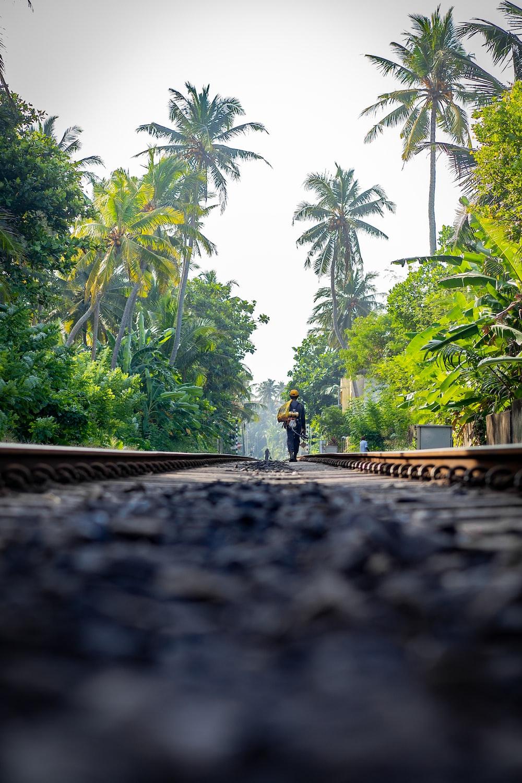 man walking on rail