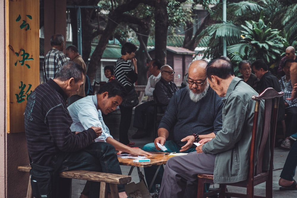 group of man playing cards