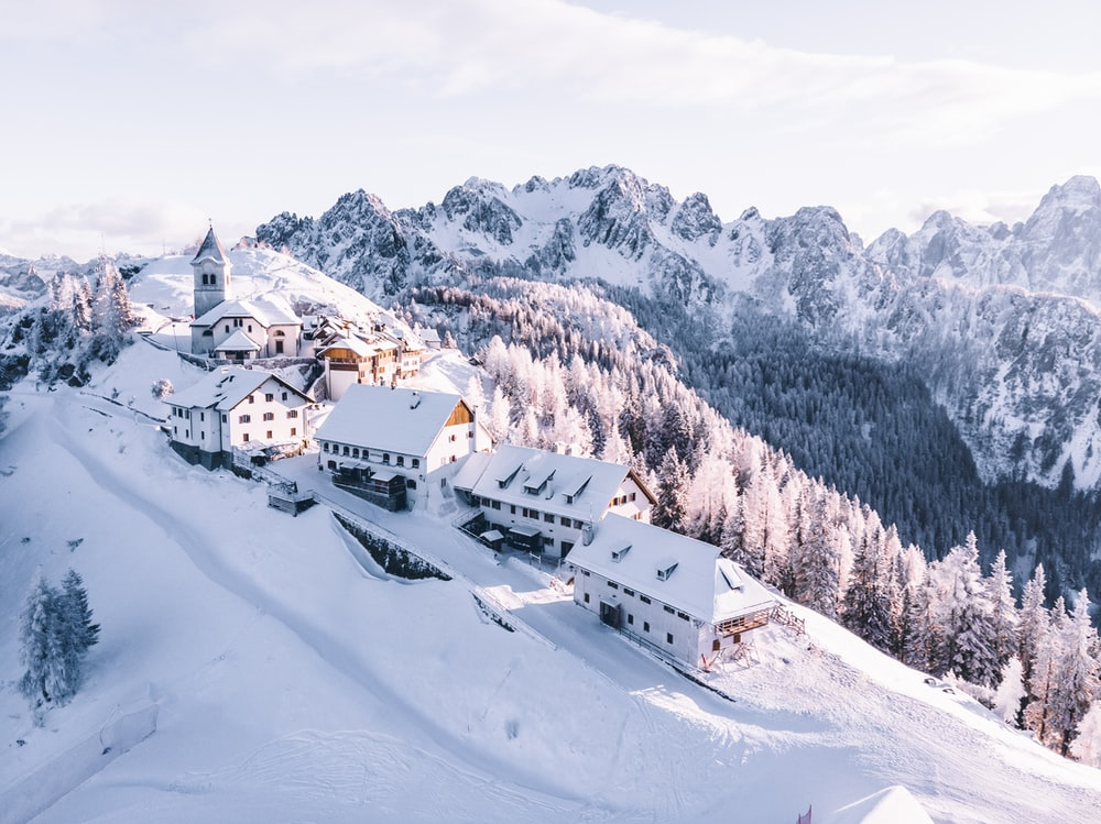 houses on mountain covered with snow