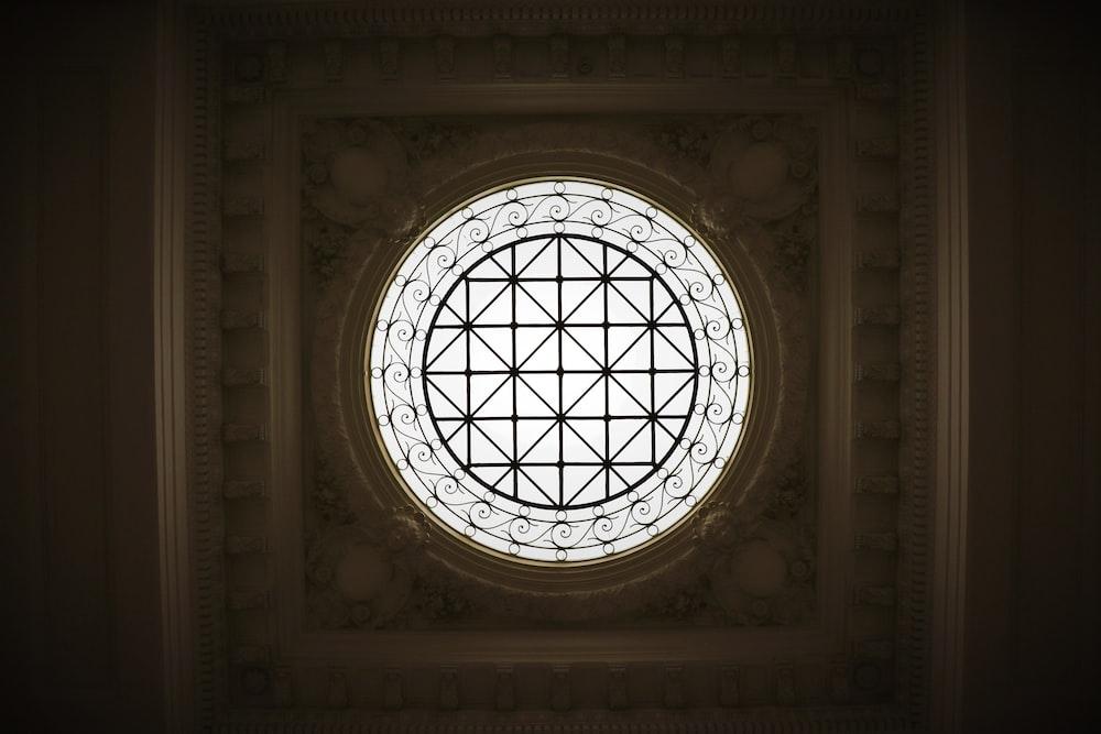 sunlight passing through round glass window