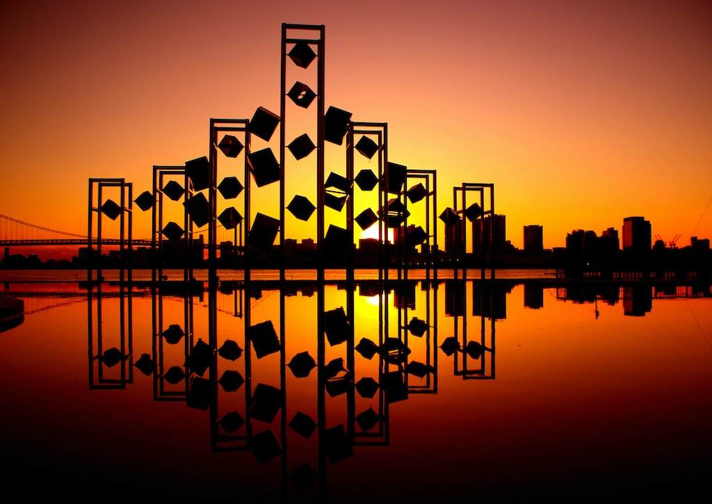 silhouette photography of an abstract building in front of cityscape