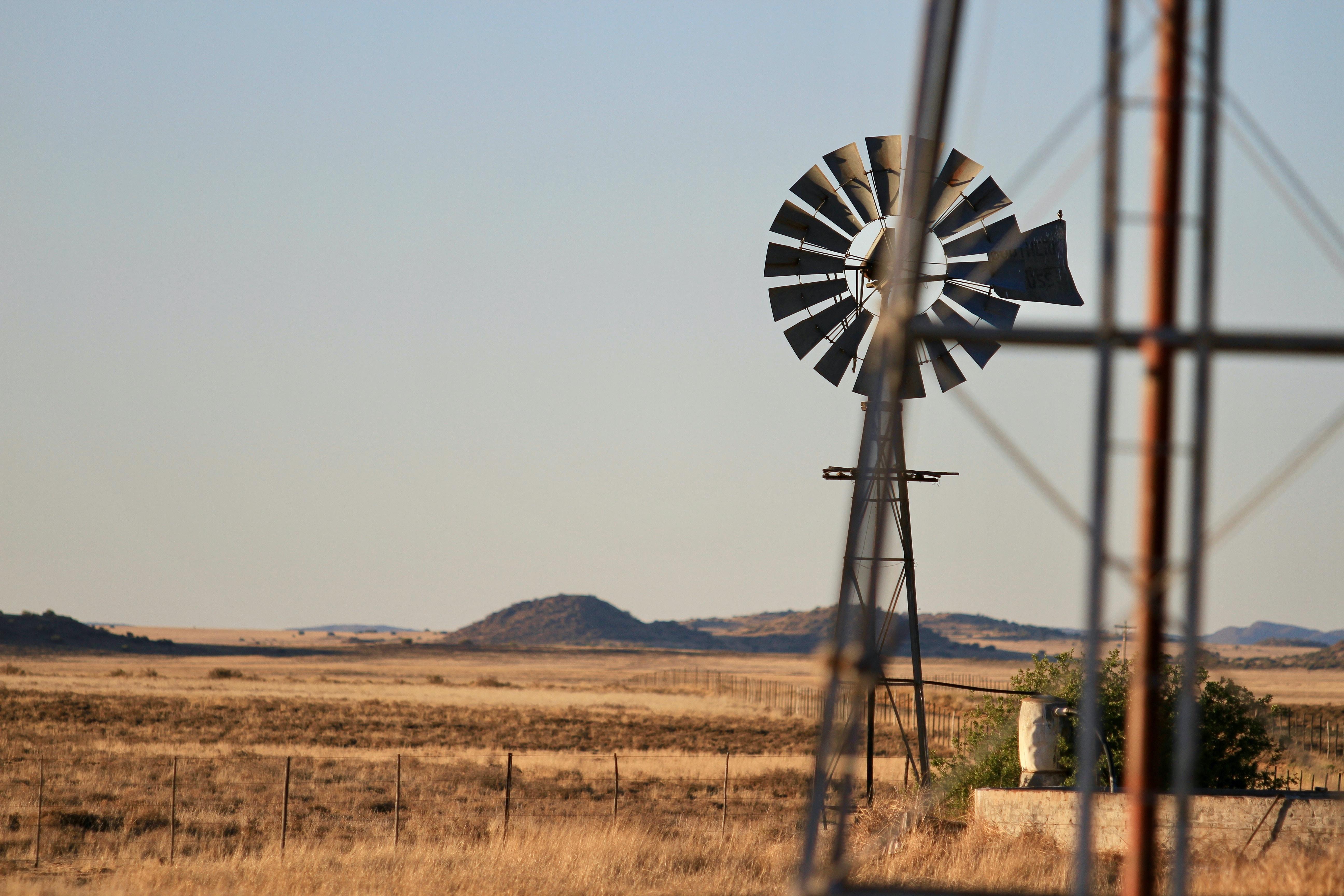 black windmill on brown field
