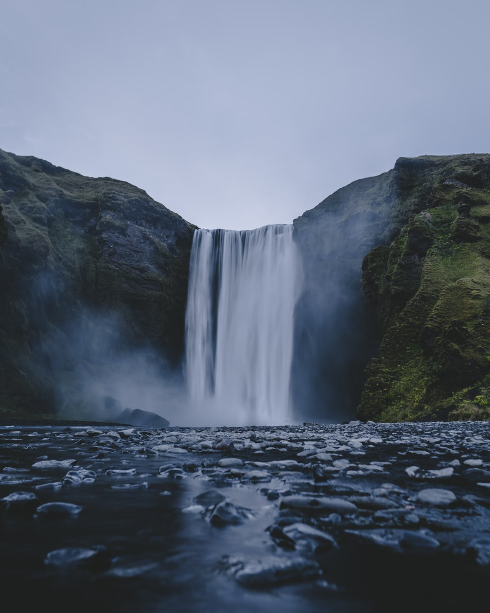 time-lapse photography of rippling plunge waterfalls