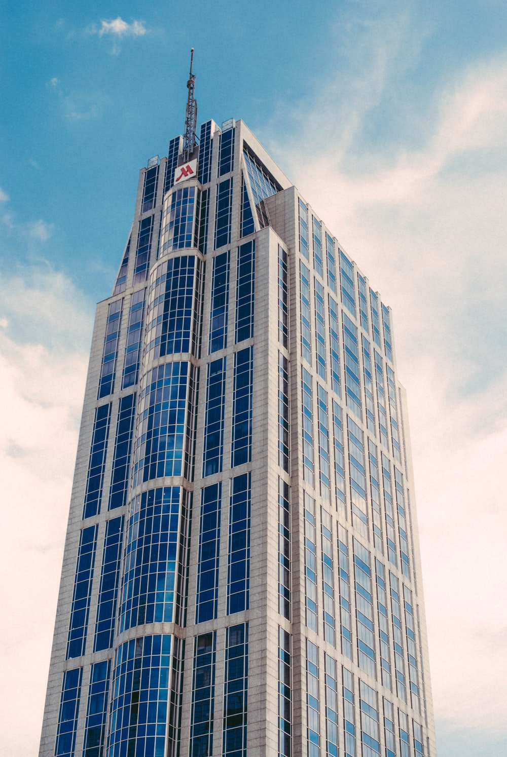 low-angle photography of curtain wall building