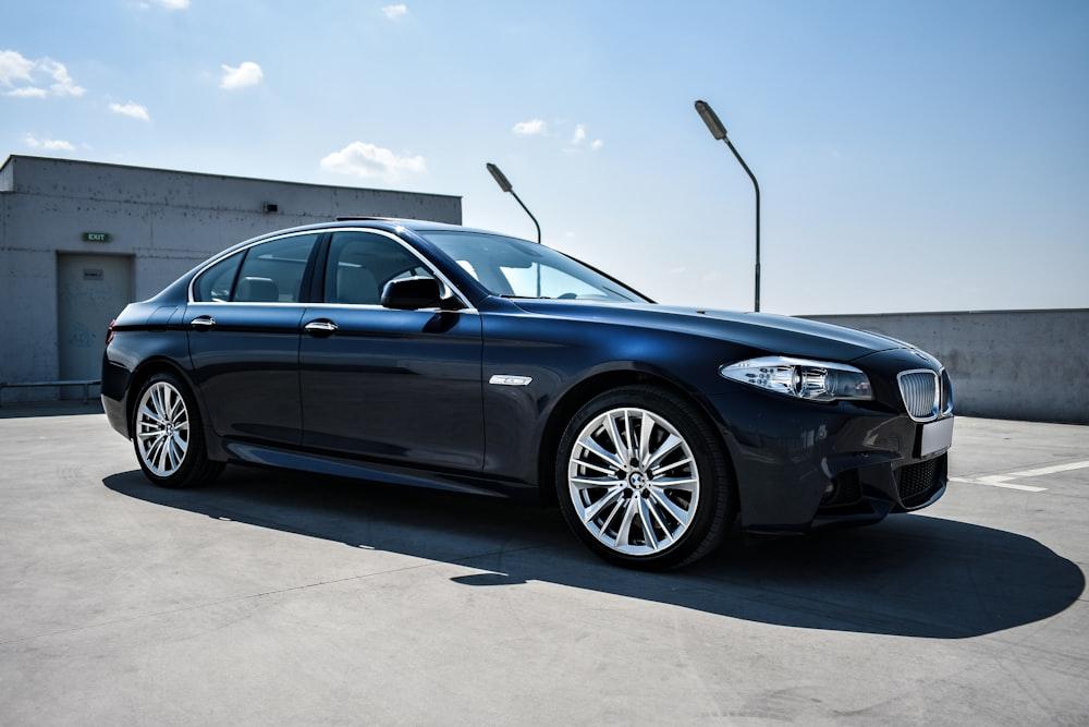 black BMW sedan on focus photography
