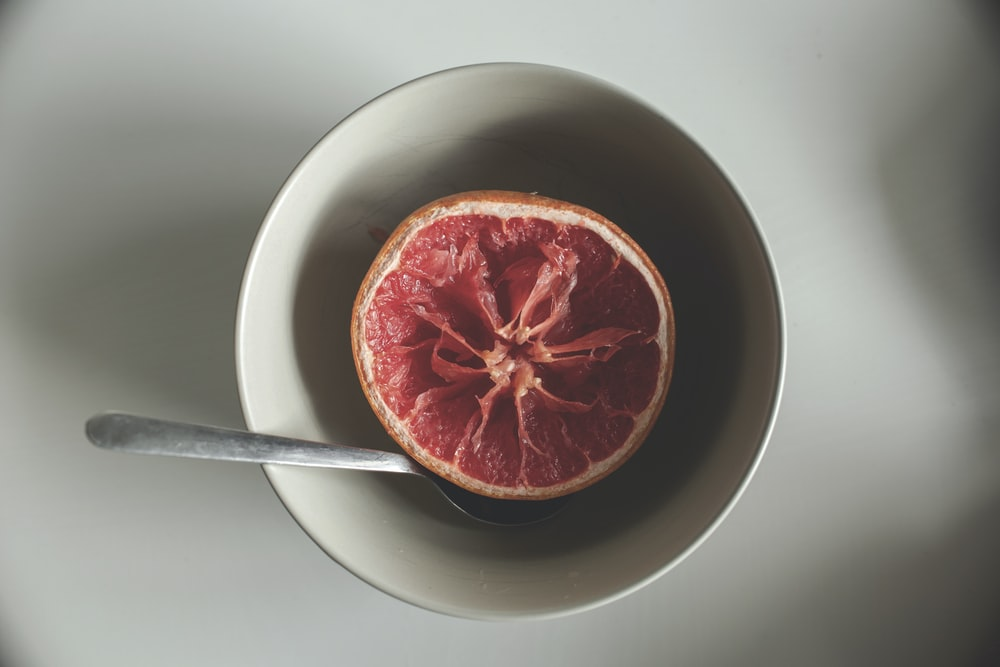 sliced grapefruit in bowl