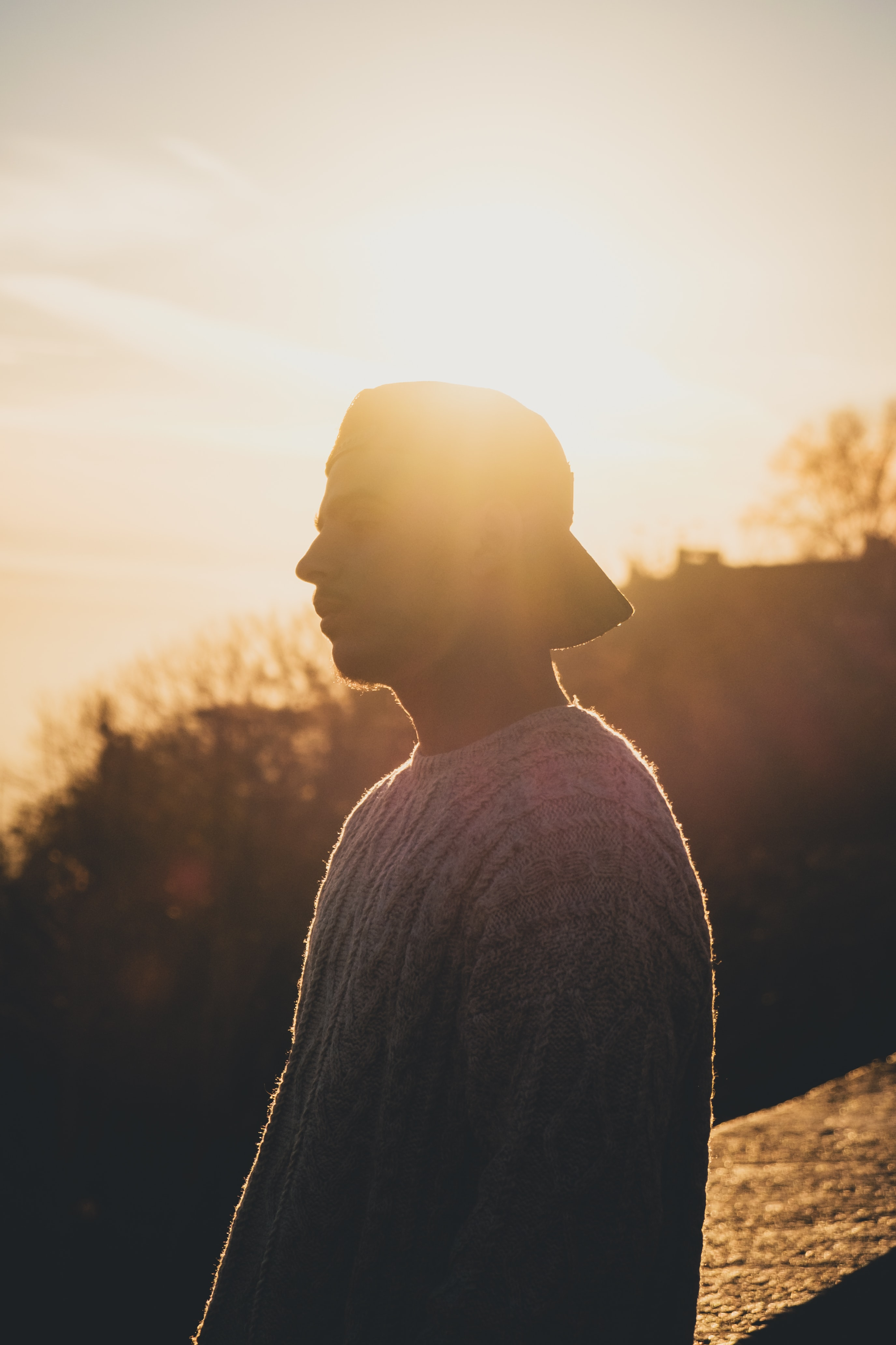 man in gray knit sweater during sunset