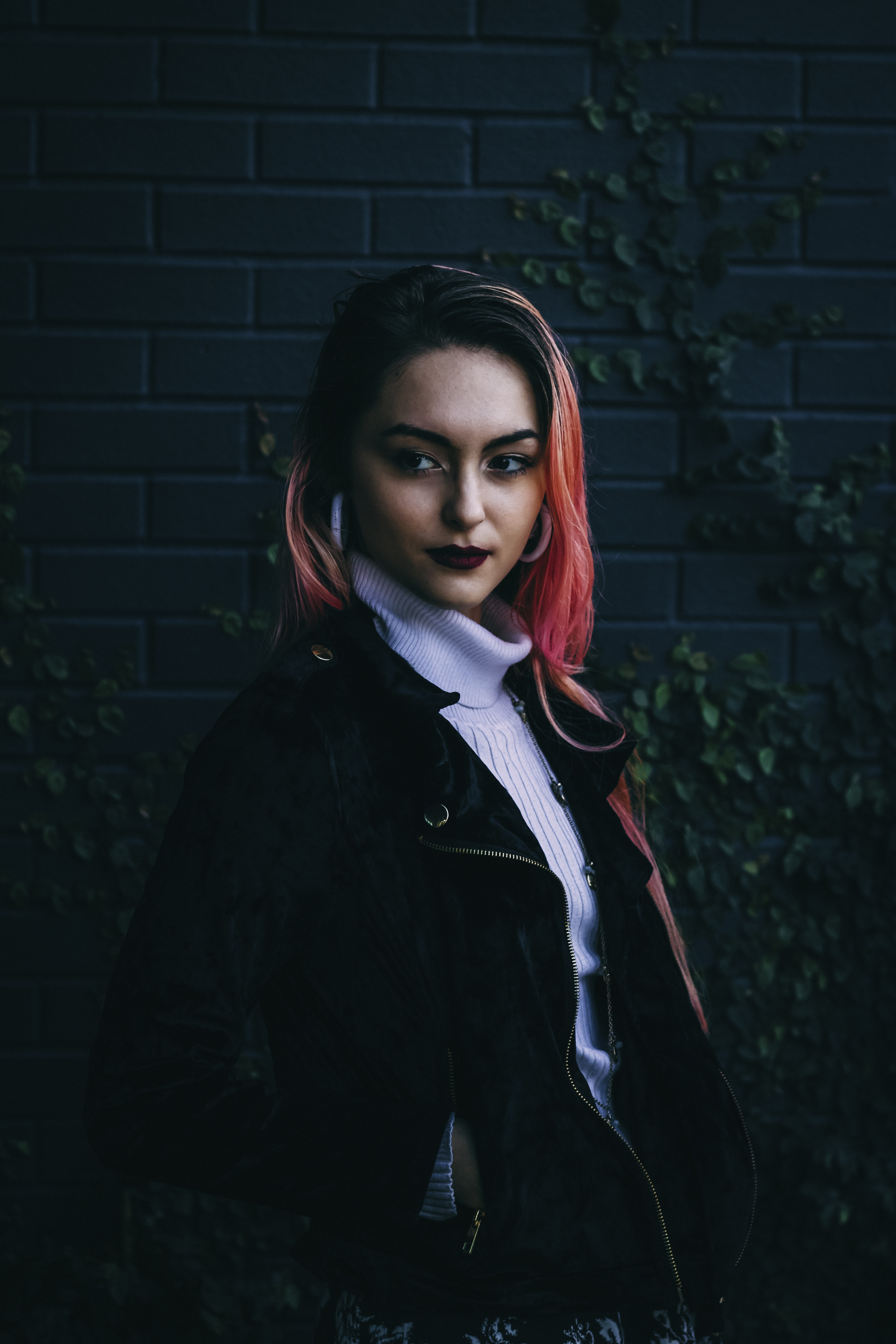 woman in black zip-up jacket with red hair