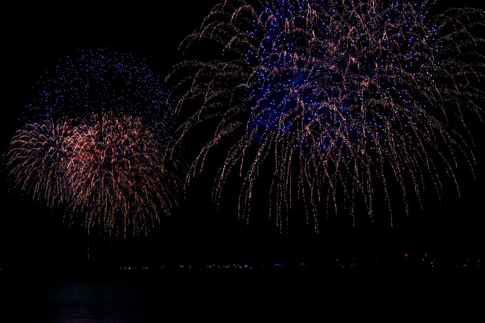 time-lapse photography of bursting fireworks in sky during nighttime