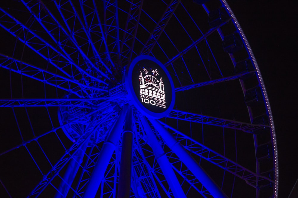 blue Ferris wheel with lights turned-on