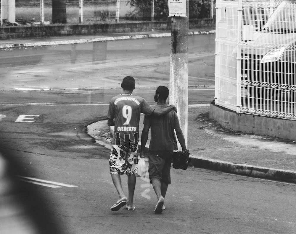 two men walking on street