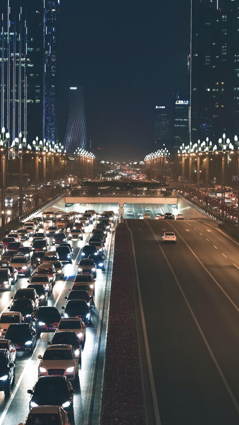 idle cars on street on nighttime