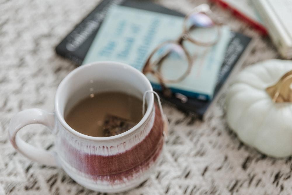 brown liquid filled ceramic mug