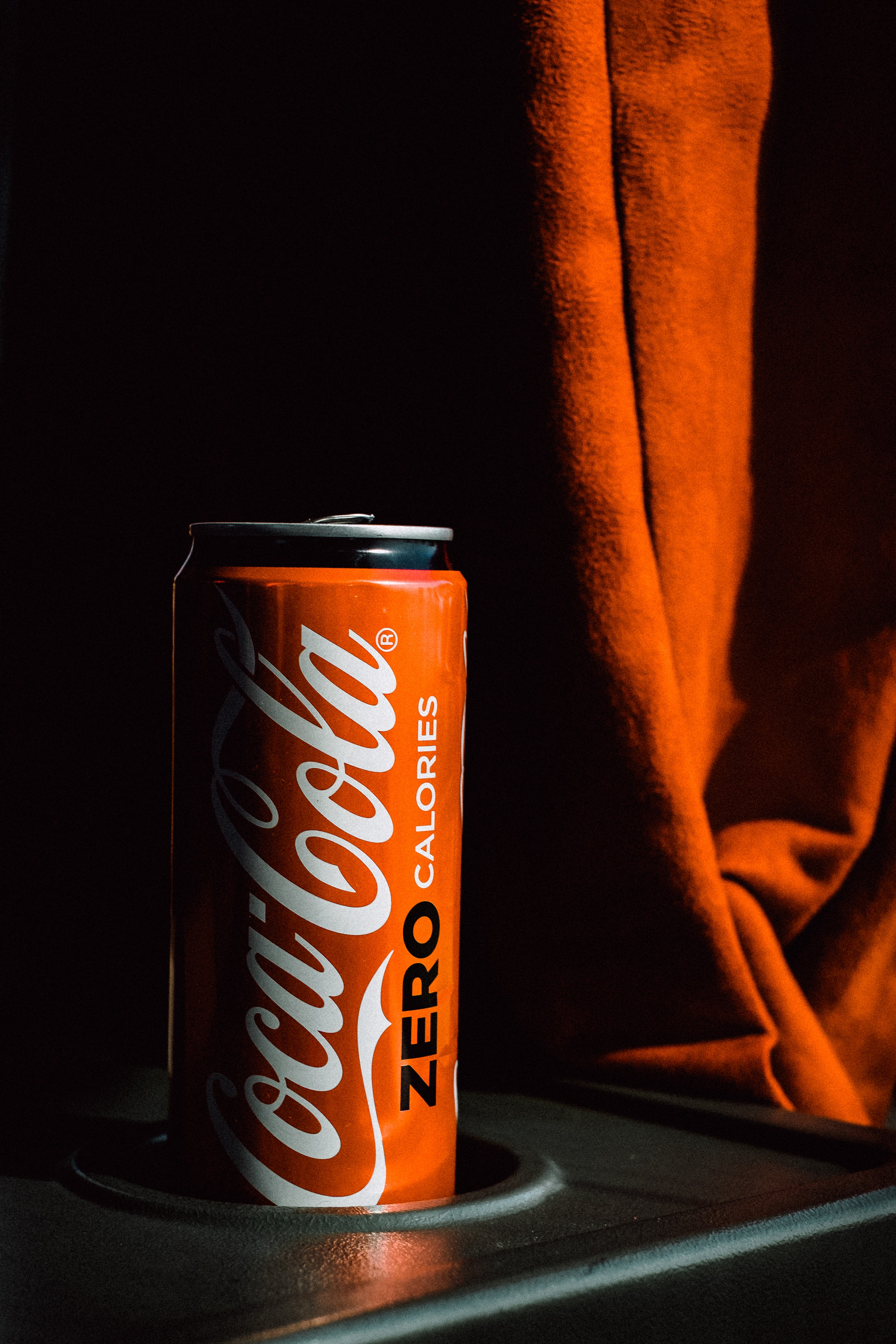 red and black Coca-Cola bottle
