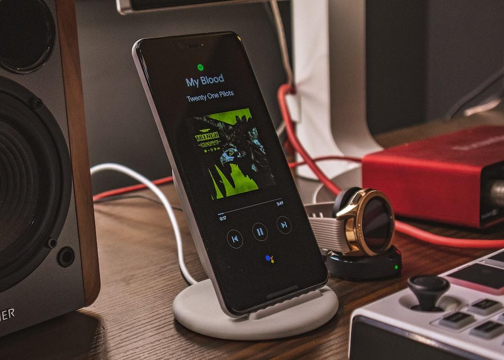 charging smartphone beside smartwatch